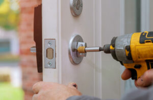Deadbolt lock being installed on front door by orange county property management